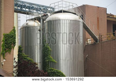 Large distillers on the outside of the Tsing Tao beer factory in Qingdao China.