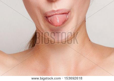 Macro image of a woman sticking her tongues out