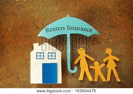Paper renters insurance family with house under an umbrella