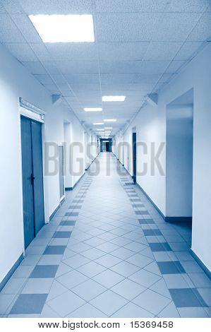 Long corridor in scientific laboratory. Bright blue tint.
