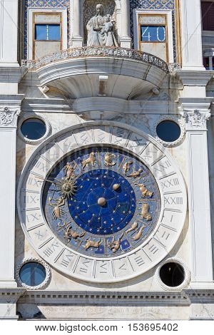 Close up view of the astronomical clock at San Marco Square in Venice (Italy). Vertically.