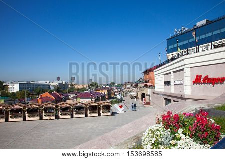 IRKUTSK RUSSIA - 17 SEPTEMBER 2016: Street with typical Russian log cabins located in the Irkutsk Sloboda (130 Quarter).