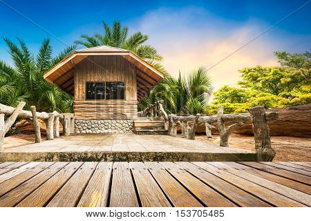 Wooden weekend house at the foothills on natural view and sunset background