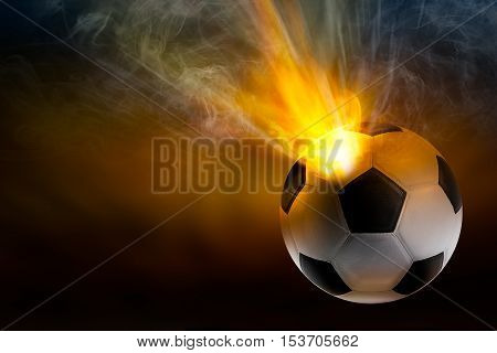 Beam of fire blaze with smoke burst out from internal soccer ball in shooting concept