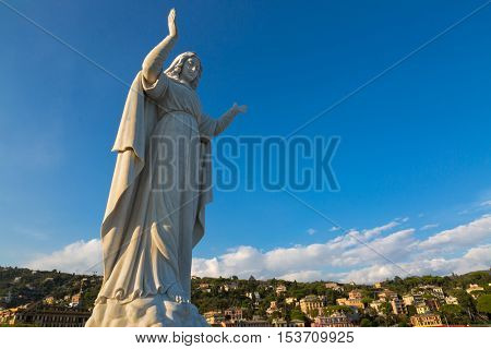 SANTA MARGHERITA LIGURE, ITALY - SEPTEMBER 2016: Statue of Santa Margherita, background of Tigullio Gulf of Santa Margherita Ligure, Italy on September 22, 2016. She prays for safe return of fishermen