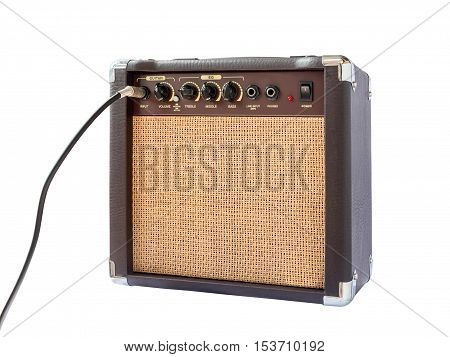 Small acoustic guitar amplifier with cable isolated on white background