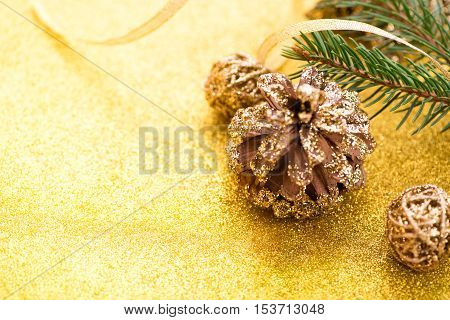 Christmas background. New year's Eve. 2017. Christmas tree, gold, cones, ornaments