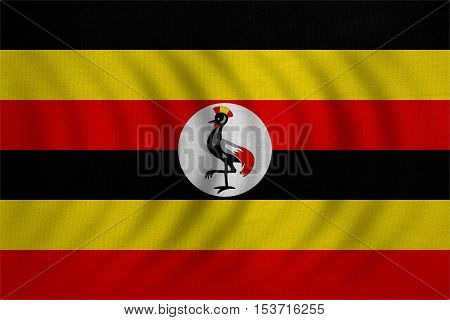 Ugandan national official flag. African patriotic symbol banner element background. Correct colors. Flag of Uganda wavy with real detailed fabric texture accurate size illustration
