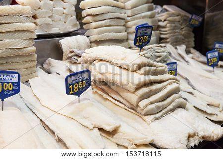 BARCELONA, SPAIN - OCTOBER 16, 2016:  Salted cod fish Bacalao La Boqueria market. La Boqueria market -is a large public market and popular tourist landmark in Barcelona