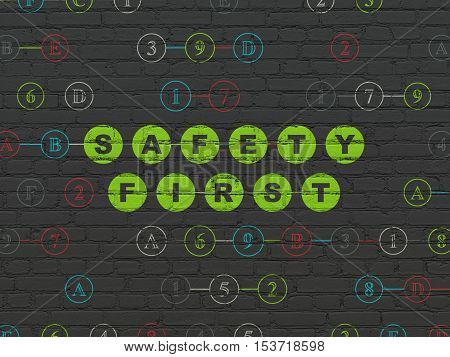 Safety concept: Painted green text Safety First on Black Brick wall background with Hexadecimal Code
