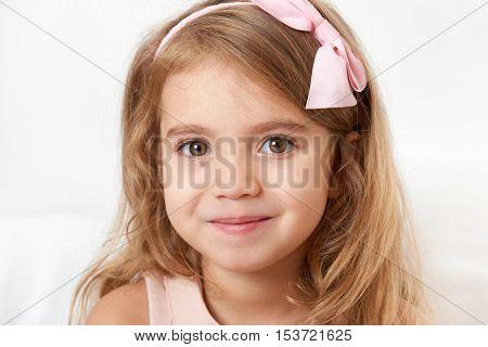 Adorable little child girl face closeup portrait