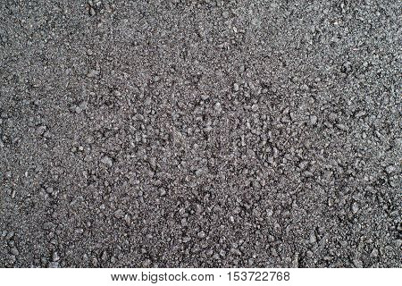 coarse black freshly made compacted asphalt closeup