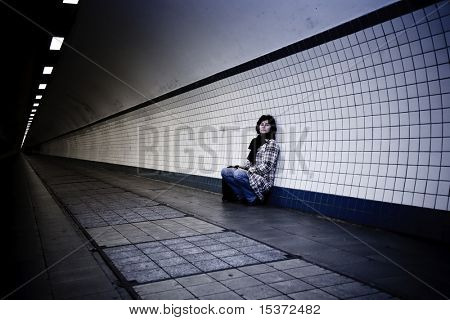 sad mature woman in a tunnel. personal editing