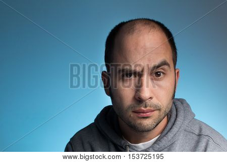 Man with puzzled expression on his face