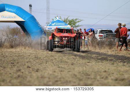 Speeding Orange Bat Rally Car At Start Of Race