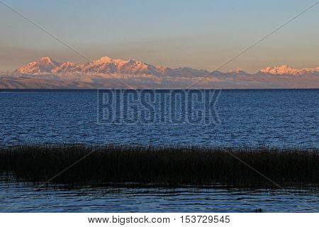 Cordillera real mountain range at sunset behind Titicaca lake, view from the peruvian side.