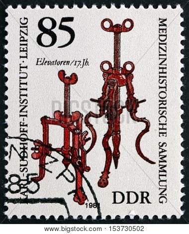 GERMANY - CIRCA 1981: a stamp printed in Germany shows Elevators 17th Century Historic Medical Instruments from Karl Sudhoff Institute Leipzig circa 1981