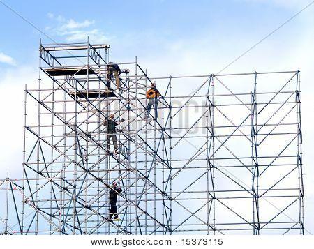Steeplejacks on a scaffold in the sky