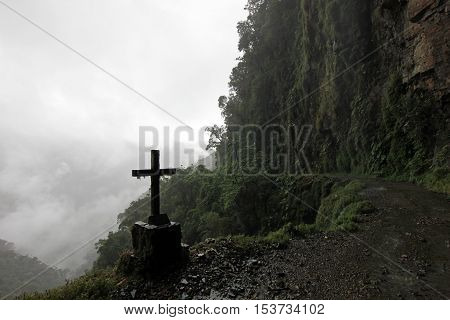 Cross on oeath road, so called the worlds most dangerous road in Bolivia South America