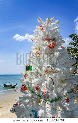 Ao Nang beach Thailand - December 25 2012: Christmas tree in front of Ao Nang beach on Christmas Day in Krabi Province southern Thailand