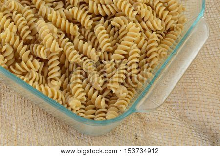 Casserole preparation of whole wheat rotini pasta in glass baking dish