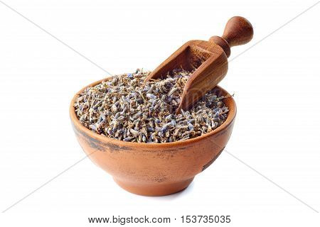 Ceramic bowl of lavander with wooden shovel isolated on white background