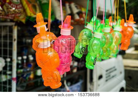 Colorful soap bubble maker for kids to make bubbles by themselves are selling in small grocery store