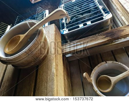 Sauna buckets and ladles with water in relaxing Nordic sauna health and wellness. pampering activity and healthy lifestyle