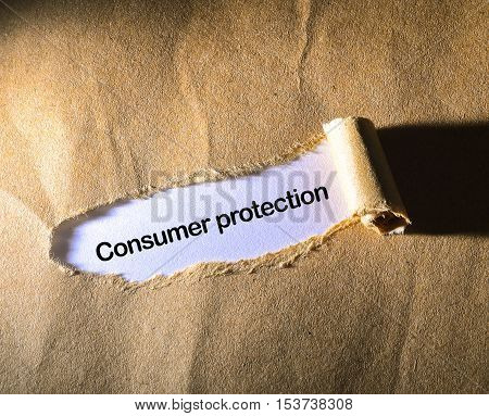 CONSUMER PROTECTION on the brown torn paper