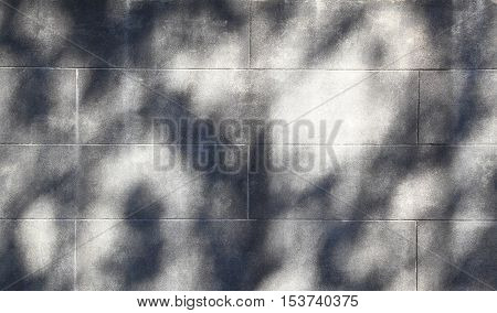 Shadows cast on a white cinder block wall form an irregular pattern that can be used for backgrounds.