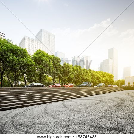 empty asphalt space with car tracks with steps in nanjing with sunbeam