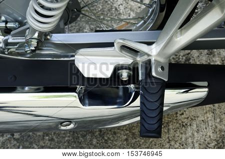 Close up of motorcycle footrest at background