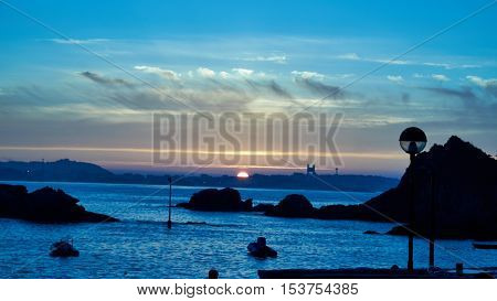 Sunset on the beach in Santa Cruz in Oleiros, Galicia, Spain