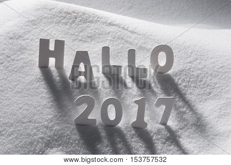 White Letters Building German Text Hallo 2017 Means Hello 2017 In Snow. Snowy Scenery For Happy New Year Greetings.