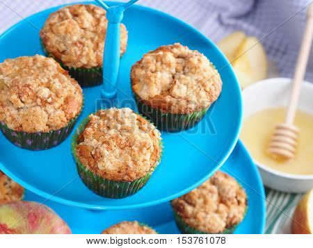 Apple crumb spiced muffins with streusel topping on b