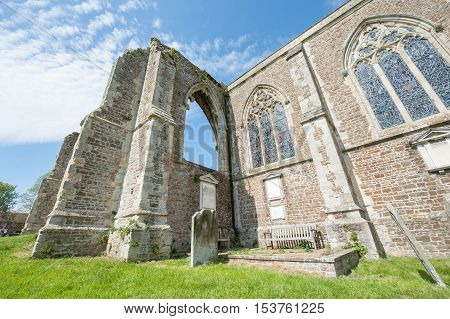 WINCHELSEA, UK - APRIL 17: Ancient ruins and more recent architecture and stained glass windows of the parish church in Winchelsea, UK on April 17, 2014