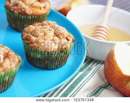 Apple crumb spiced muffins with streusel topping on blue