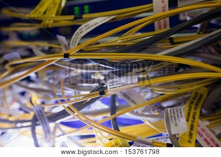 Close-up of connected wires of rack mounted server in server room