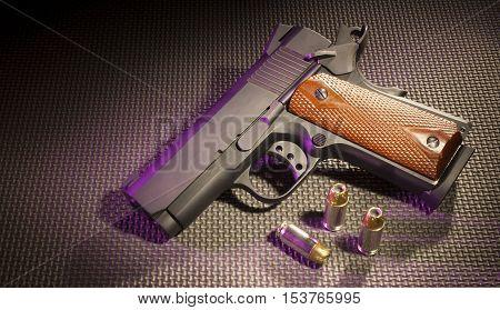 Semi automatic handgun with ammunition on a rubber mat