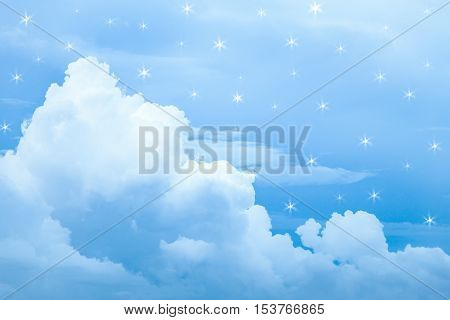 Blue cloud floating on blue sky with fake star light surround cloud.