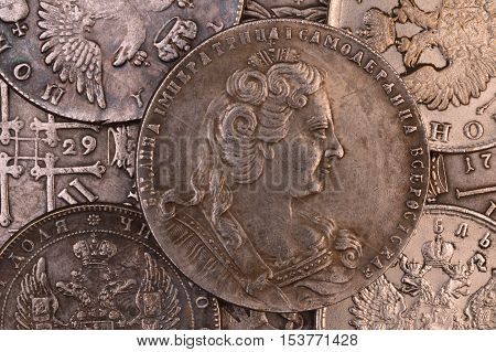 Vintage background silver coin Russian ruble in 1730 Empress Anna autocrat of all Russia
