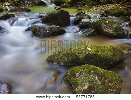Stream running over some rocks in Pisgah National Forest in North Carolina