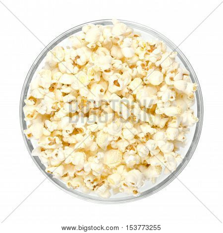 Popped popcorn in glass bowl on white background. Butterfly shaped popcorn puffed up from the kernels, after it has been heated. Edible and vegan food. Isolated macro photo close up from above.