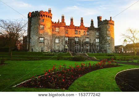 Kilkenny Castle and gardens in the evening. It is one of the most visited tourist sites in Ireland