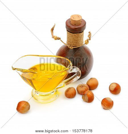 Oil and fruit hazelnut isolated on white background