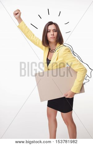 serious businesswoman showing board or banner with copy space on white background. concept of leadership
