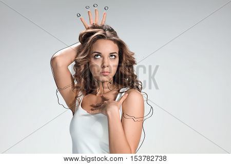 Handsome narcissistic proud young woman on gray