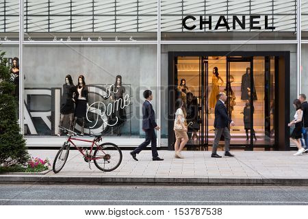 TOKYO, Japan - 24th June 2016: Shoppers pass by the French couture store Chanel in the expensive shopping district of Ginza.