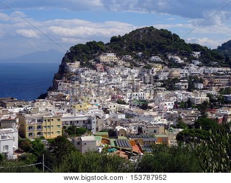 Typical view of the island of Capri, Italy, with small houses built between the mountains and the green vegetation. Photograph taken in the center of the island.