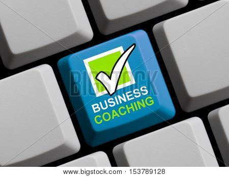 Blue computer keyboard is showing Business Coaching
